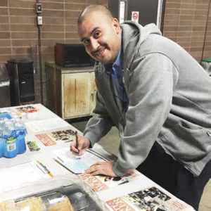 Edgardo Fuentes signing a union card during a break from his SoCalGas training.