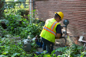 In Illinois, legislators approved funding for the Peoples Gas Accelerated Main Replacement Program in Chicago. Pictured here, installing new service for a residential customer.