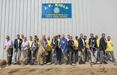 Pictured here at the J.F. Kiely groundbreaking ceremony are:  Local 409 VP Steve Becker, far left, Local President Vinny Hewatt, fourth from left, Nyle, next to him, with John and Jack Kiely, center, company managers and Local 409 members in yellow shirts.